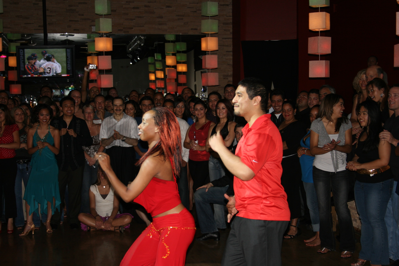 Latin/salsa dancers in red